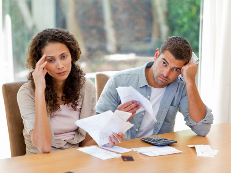 A couple looks stressed that there in debt