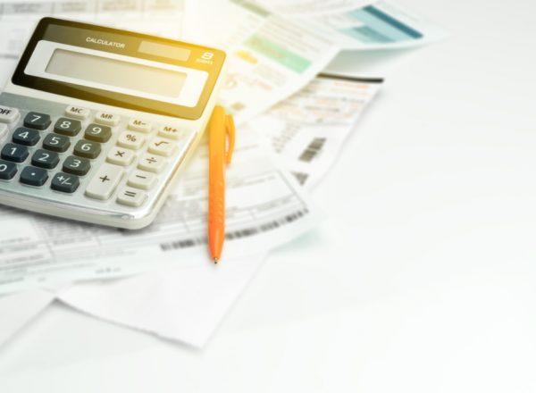 Calulator, bills and pen
