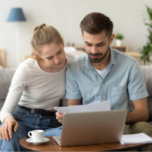 Couple reading a financial letter
