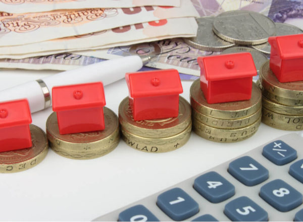 Stack of pound coins with red houses on top
